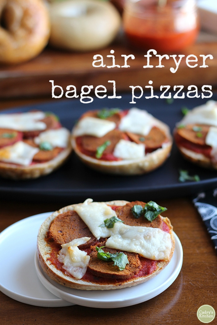 Lunch is ready in 10 minutes with these vegan air fryer bagel pizzas! They are topped with seitan pepperoni, non-dairy cheese, and fresh basil. #kidfriendly #vegan #vegetarian #airfryer