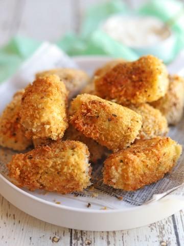 Fried artichoke hearts on platter.
