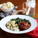 Vegan BBQ bowl with Soy Curls, collard greens, and potato salad.