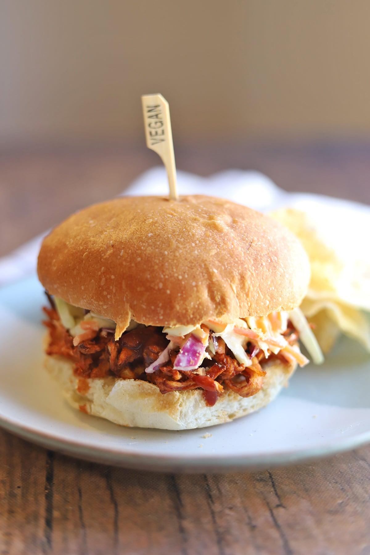 Vegan pulled pork sandwich on table.