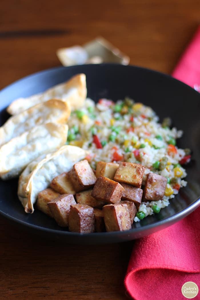 Trader Joe's teriyaki baked tofu, Thai vegetable gyoza, and cauliflower rice.