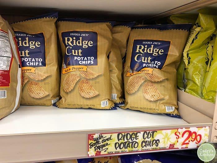 Bag of Trader Joe's ridge cut salt and pepper potato chips on shelf.