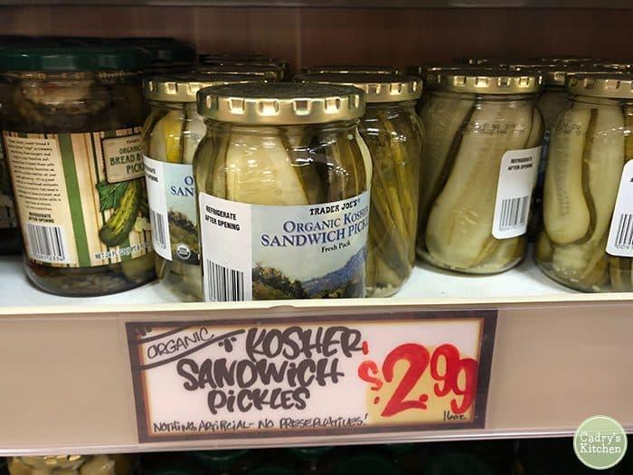 Kosher sandwich pickles from Trader Joe's on shelf.