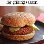 Text overlay: The best vegan burgers for grilling season. Beyond Meat burger on plate with pickles.