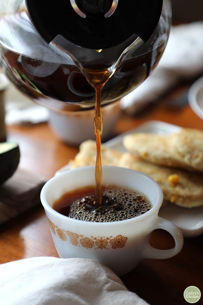 Coffee pouring into cup.