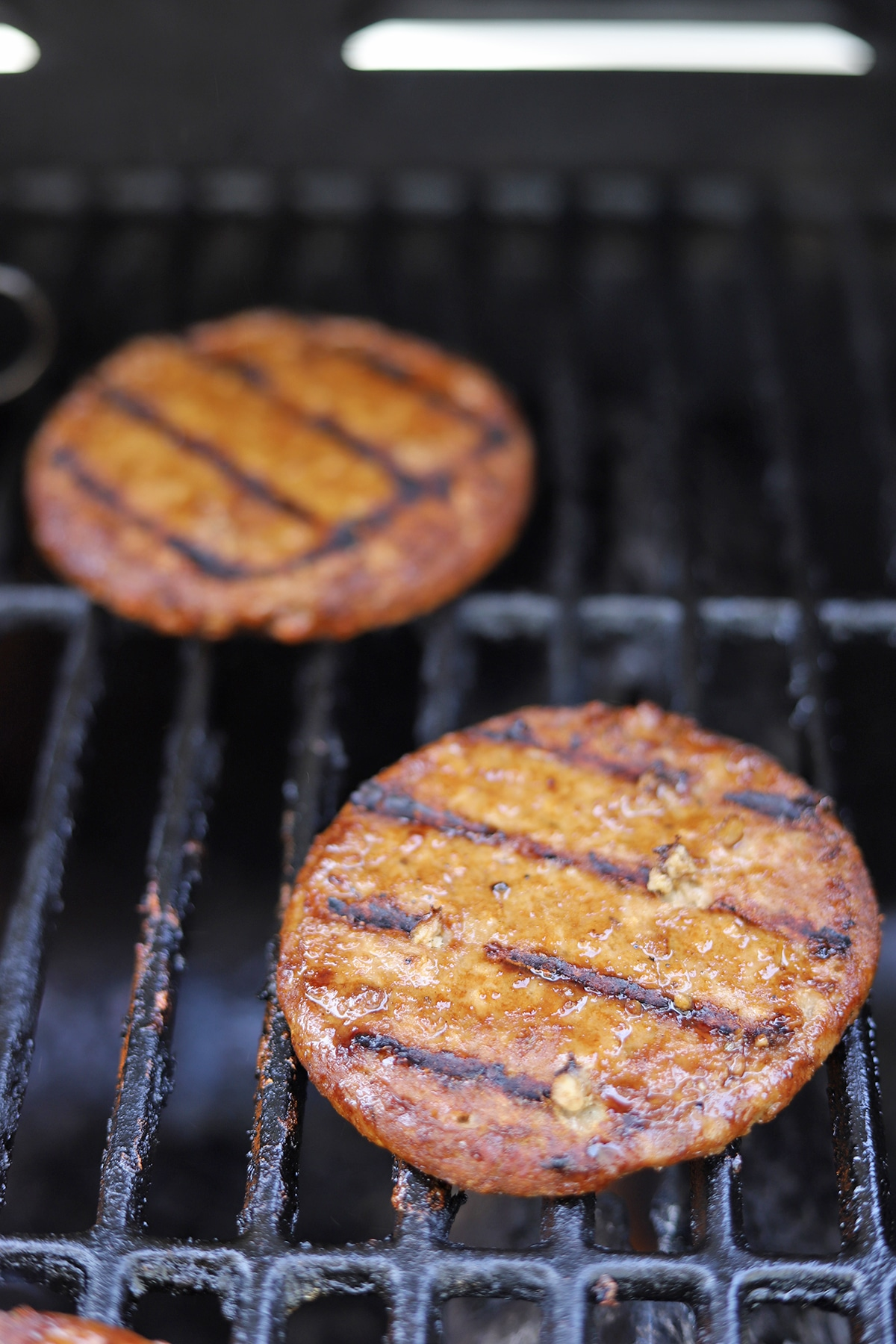 Close-up Gardein burgers on grill.