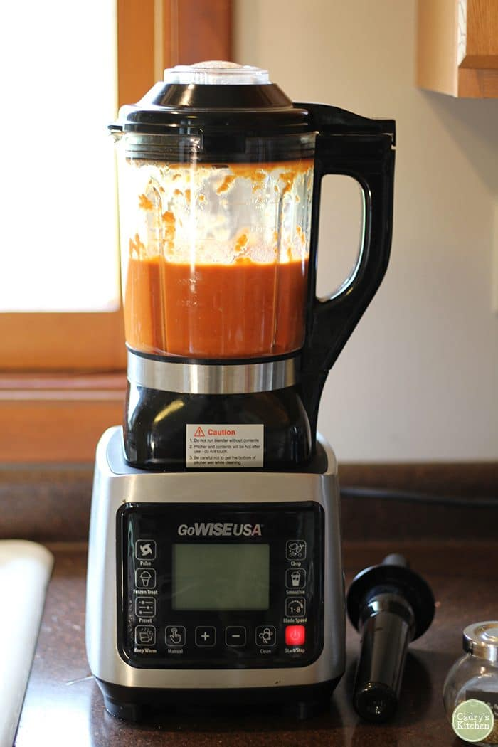 GoWISE heated blender with tomato soup in pitcher.