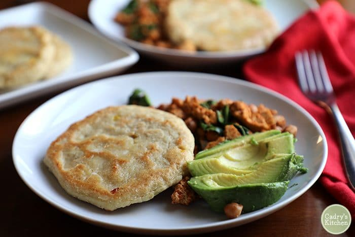 Masa corn cake on plate with tofu scramble and avocado.