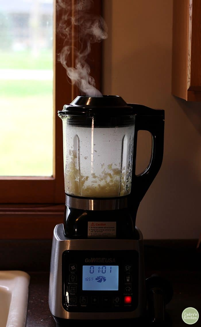 GoWISE heated blender filled with onions and steaming.