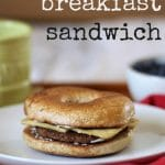 Vegan breakfast sandwich with eggy tofu, Gardein breakfast patty, non-dairy cream cheese on rosemary olive oil bagel.