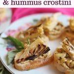 Text overlay: Grilled artichoke & hummus crostini. Crostini on platter.