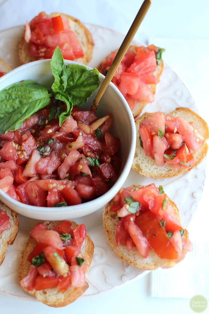 Overhead tomato bruschetta appetizer with basil.