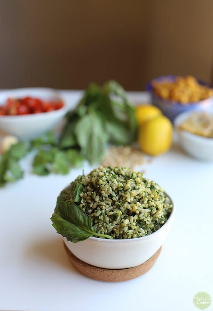 Pesto rice bowl with fresh basil in bowl.