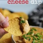 Vegan chili cheese dip on tortilla chip with bowl of queso + text.