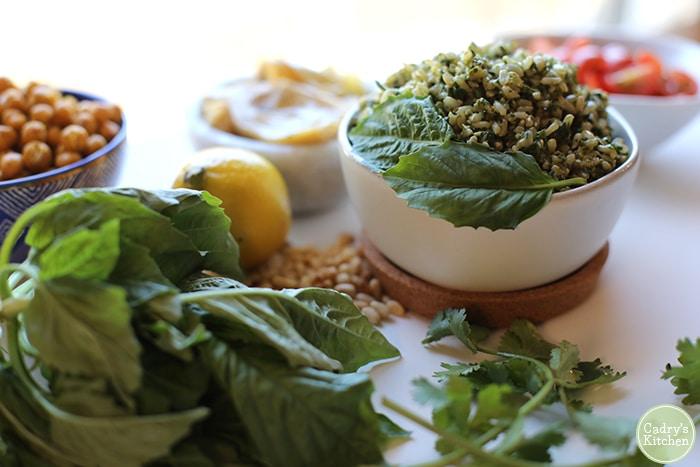 Vegan pesto rice with basil, cilantro, pine nuts, and lemon.