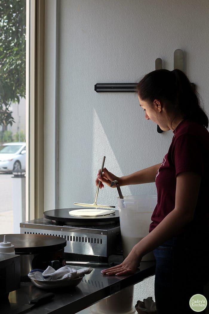 Woman making crepe at Crepe & Spoon in Minneapolis.
