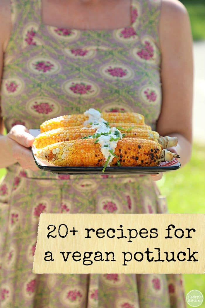 20+ recipes for a vegan potluck text & grilled corn on the cob on a platter.