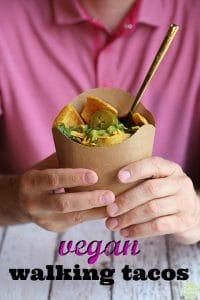 """Hands holding vegan walking taco + text that says """"vegan walking tacos."""""""