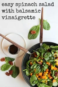 Overhead easy spinach salad with balsamic vinaigrette + text.