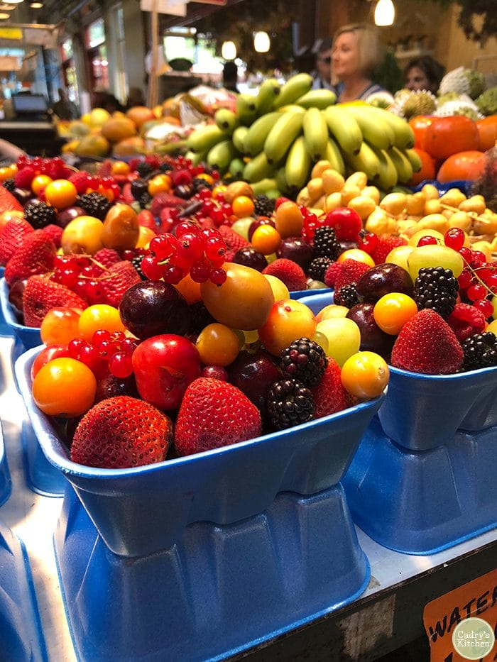 Berries in styrofoam containers at Granville Island Public Market.