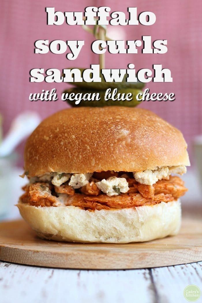 Buffalo Soy Curls sandwich with vegan blue cheese dressing + text.