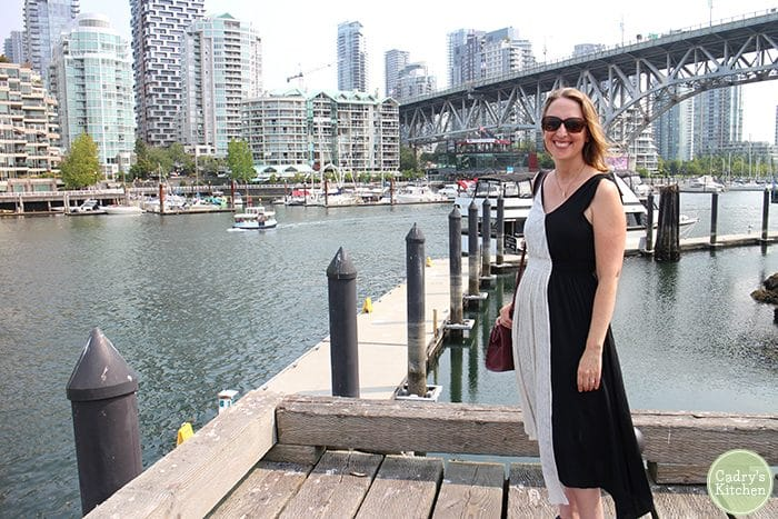 Cadry standing on dock at Granville Island, Vancouver.