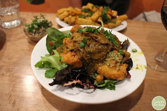 Fried cauliflower on salad at Chickpea vegan Vancouver.