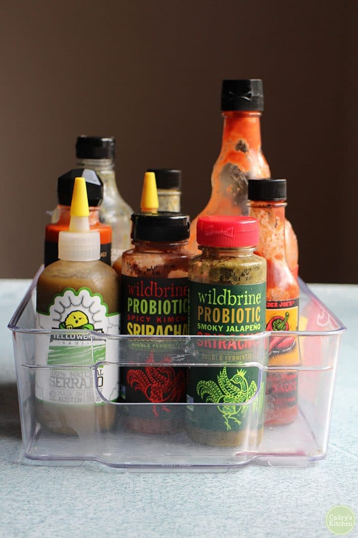 Top hot sauces in basket for refrigerator.