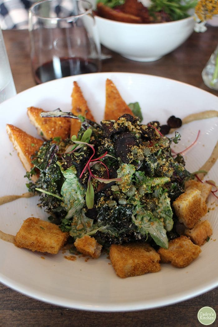 Kale Caesar salad with cornmeal crusted tofu and croutons at Modern Love Omaha.