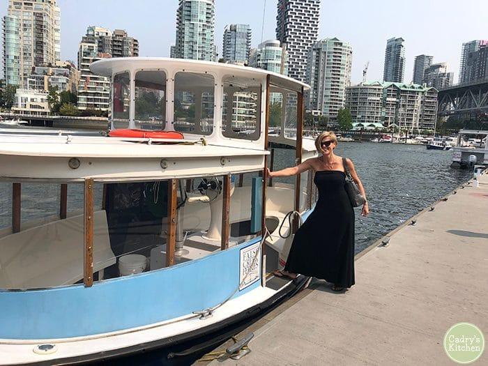 Kristy standing on False Creek Ferries boat.