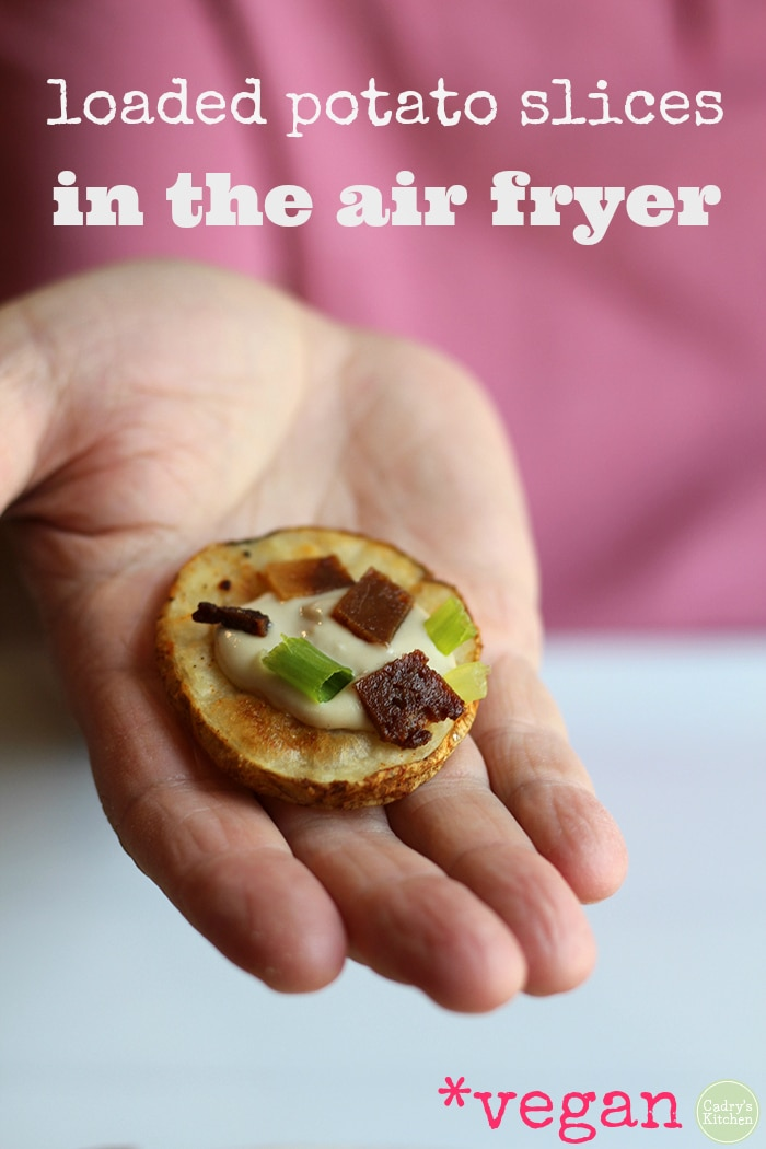 Surprise your dinner party guests with these eye-catching loaded potato slices cooked in the air fryer. These sliced potatoes are almost like crostini. With decadent cashew cream, smoky seitan bacon, and a smattering of green onions, your guests will be raving about it. #appetizers #vegan #starter #potato #vegetarian #airfryer