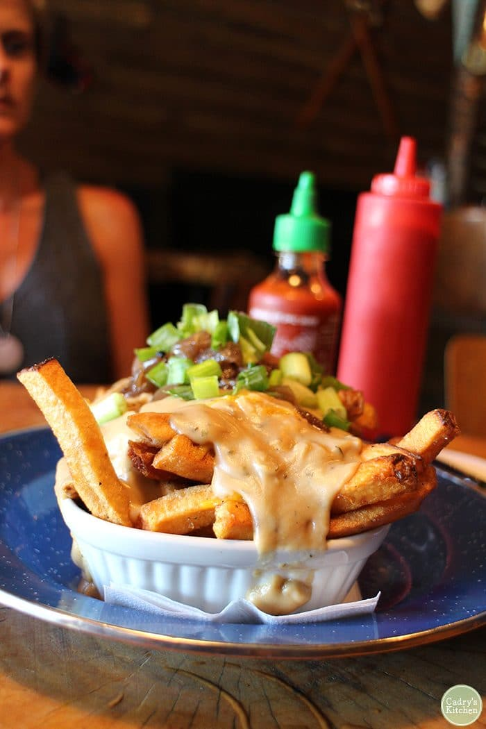 Vegan poutine covered in gravy.