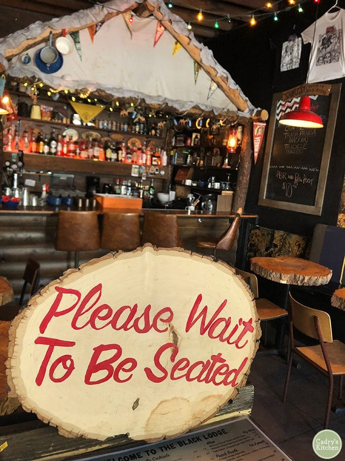 Please Wait To Be Seated sign at the Black Lodge vegetarian restaurant in Vancouver.