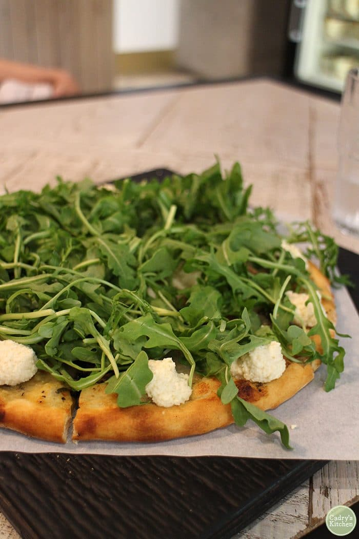 Mushroom pizza with arugula at Virtuous Pie.