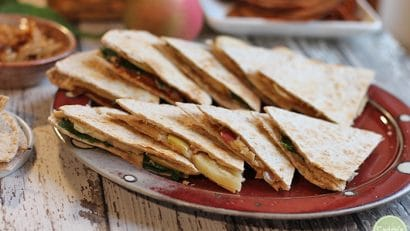 Vegan quesadillas with apples, caramelized onions, and spinach.