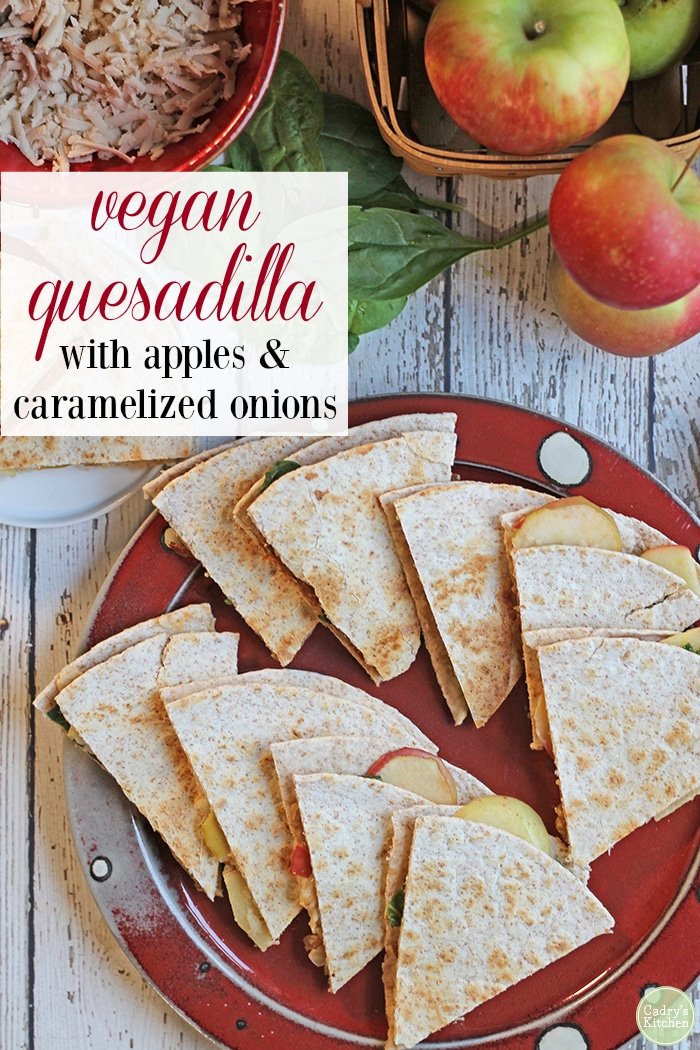 Overflowing in apples from an apple picking excursion? Make a veggie quesadilla with slices of honeycrisp apple, smoked vegan mozzarella, caramelized onions, and baby spinach. It's the quintessential autumn appetizer. #appetizer #vegan #vegetarian #nondairy #quesadilla #snack #kidfriendly #apples #fall #autumn