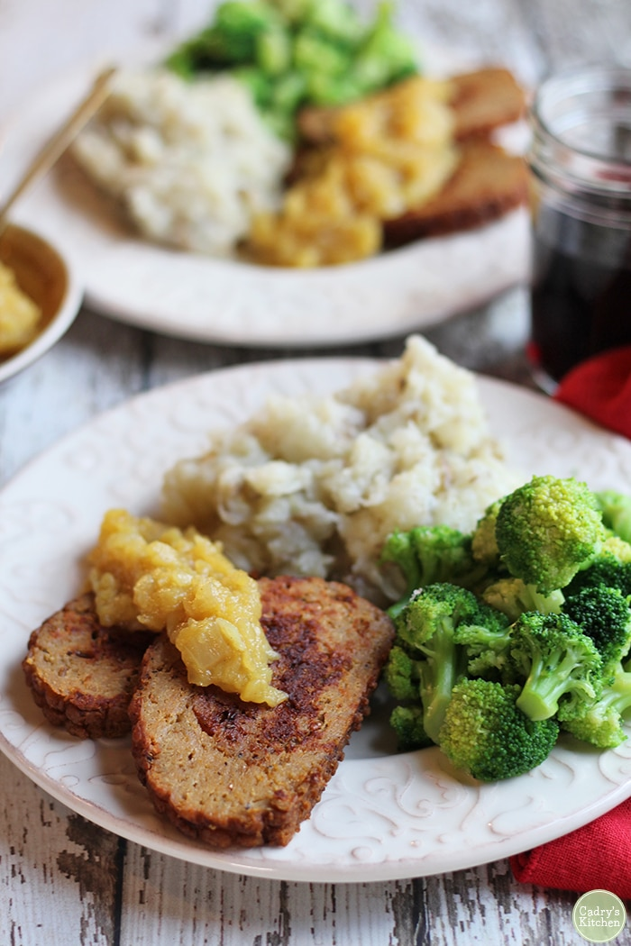 Field Roast Celebration Roast with apple chutney, mashed potatoes, and broccoli on plate.