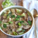 Text overlay: Vegan miso soup. Close-up bowl of soup and spoon.