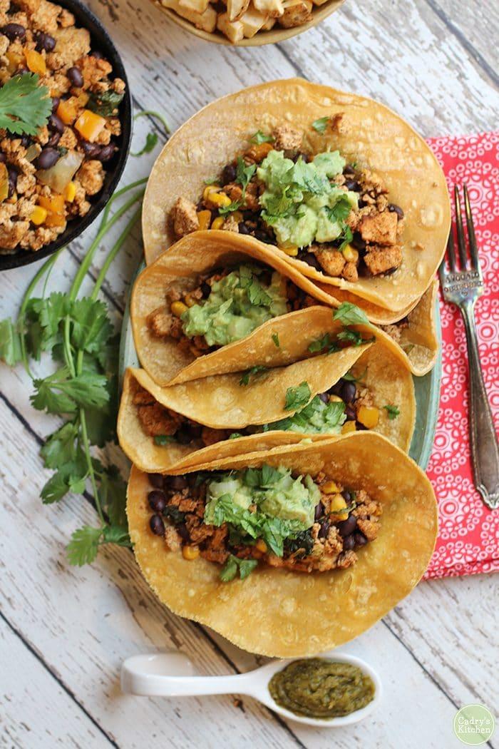 Overhead vegan breakfast tacos with guacamole.