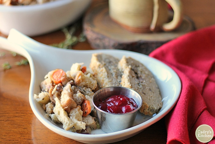 Vegan stuffing, Trader Joe's turkeyless roast, and cranberry sauce on plate.