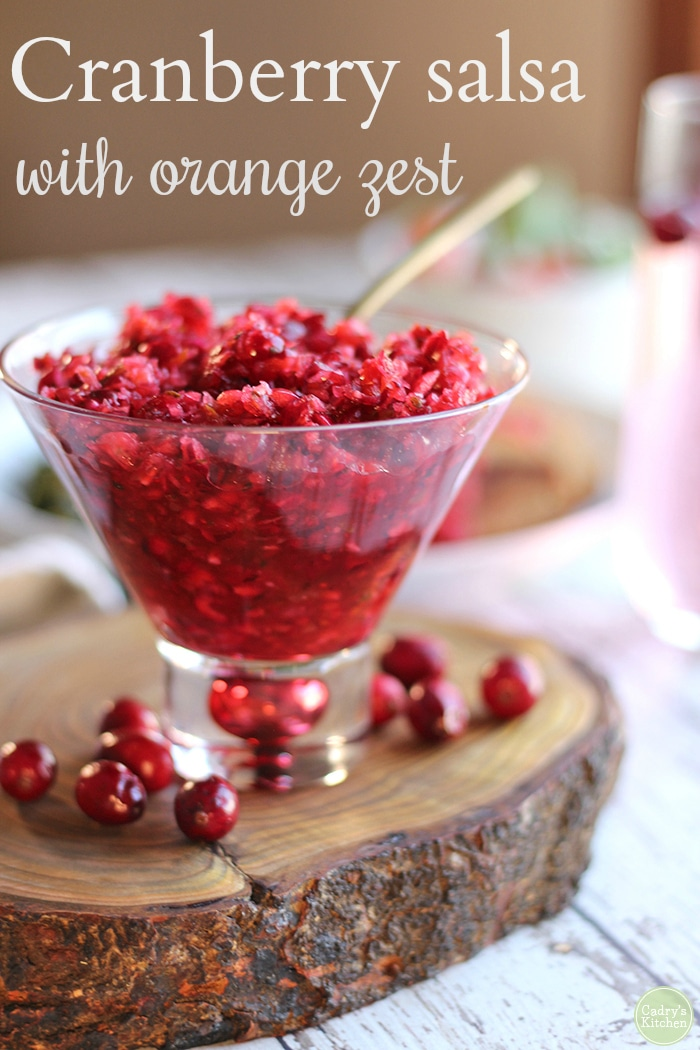Cooked cranberry sauce is a holiday classic. But it also can be a little humdrum. Mix things up with fresh cranberry salsa. This vibrant salsa is packed with cilantro, red bell pepper, onions, garlic, lime juice, orange zest, and orange juice. It really wakes up the palate on a meal of comfort foods. Vegan & gluten-free. #vegan #glutenfree #holidays #thanksgiving #christmas #cranberries #sides #sidedishes