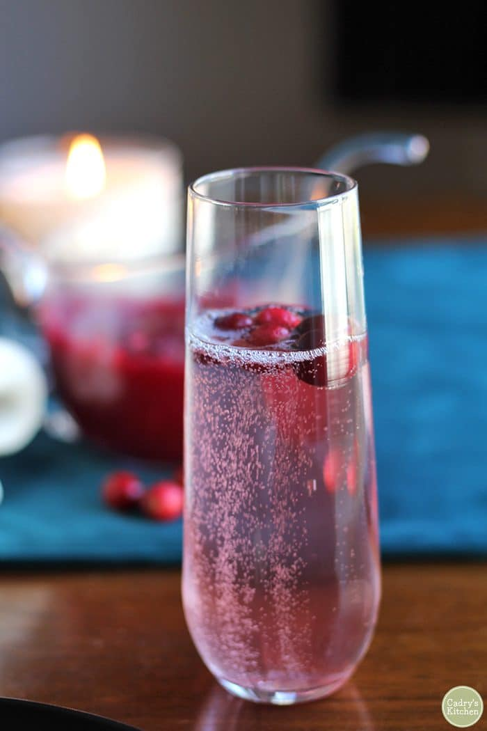 Cranberry mimosa in champagne flute.