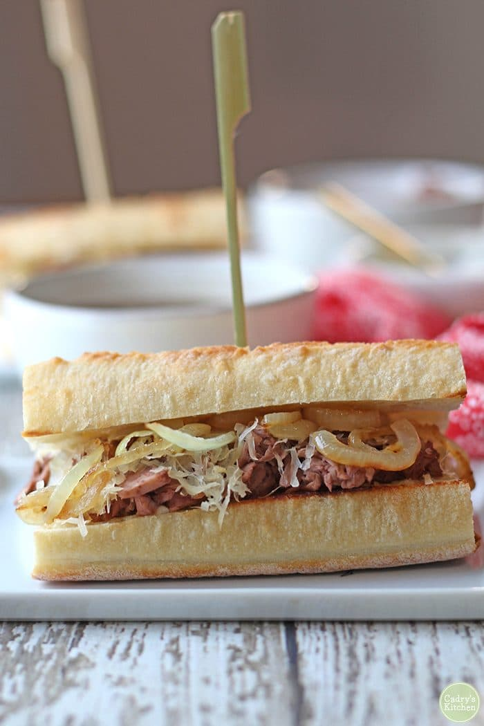 Vegan French dip sandwich on table.