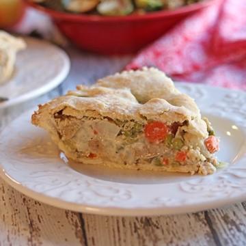 Slice of vegan pot pie on white plate.