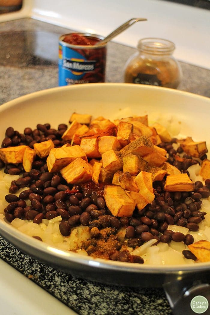 Sweet potato and black bean mixture in skillet.