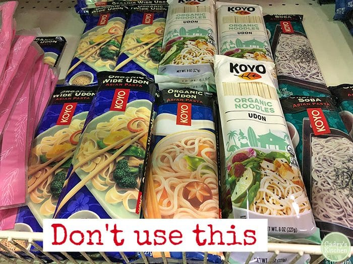 Shelf stable packages of dried udon noodles. Text: Don't use this.