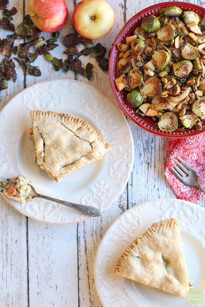 Overhead slices of vegan pot pie & Brussels sprouts.