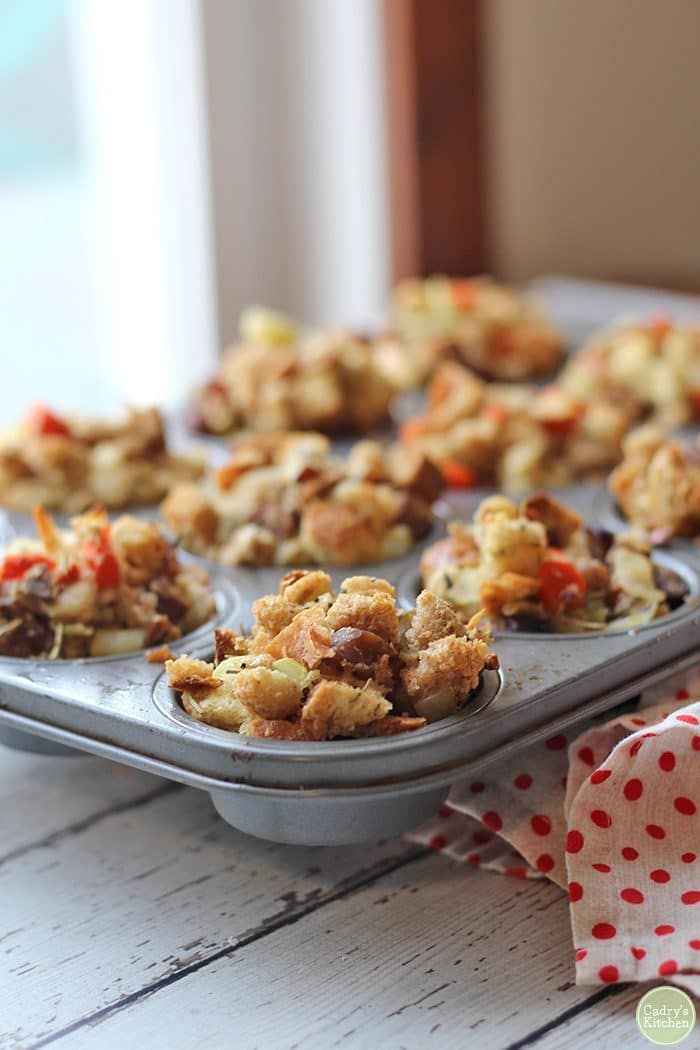 Stuffing muffins in muffin pin by polkadot napkin.