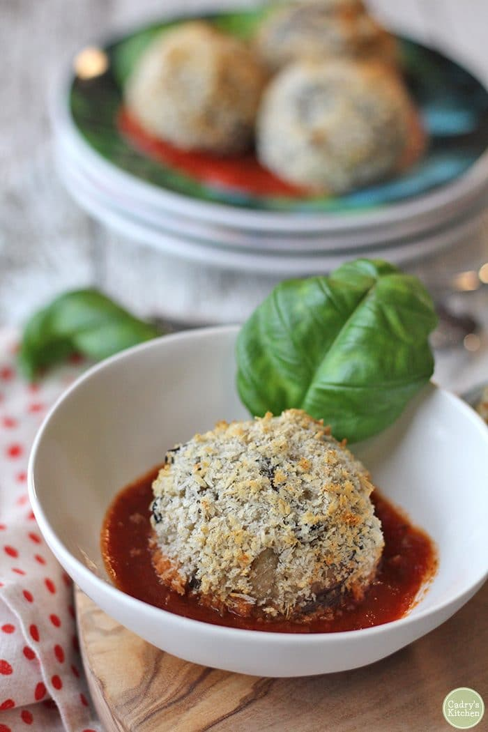 Vegan risotto ball in marinara with basil.