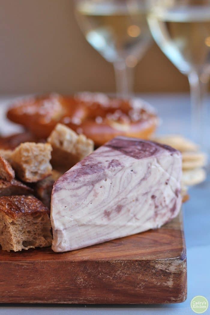 Herbivorous Butcher Havarti Reserva on board with pretzels and bread.